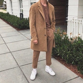 White and Red Leather Low Top Sneakers Outfits For Men: A camel overcoat and khaki chinos are the kind of a no-brainer combo that you so terribly need when you have no time to spare. Stick to the casual route in the shoe department with white and red leather low top sneakers.