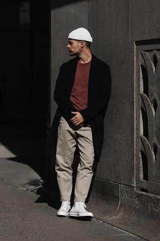 Burgundy Crew-neck T-shirt Outfits For Men: A burgundy crew-neck t-shirt and khaki chinos are the kind of a fail-safe off-duty look that you so desperately need when you have zero time. You can get a bit experimental when it comes to shoes and dial down this ensemble by finishing with a pair of white canvas high top sneakers.
