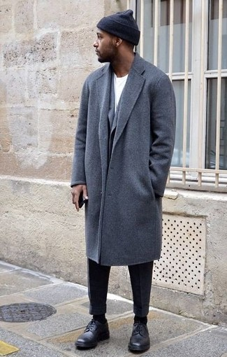 How to Wear a Grey Overcoat: To look good and classic, reach for a grey overcoat and black dress pants. Why not take a more relaxed approach with shoes and introduce black leather derby shoes to the equation?