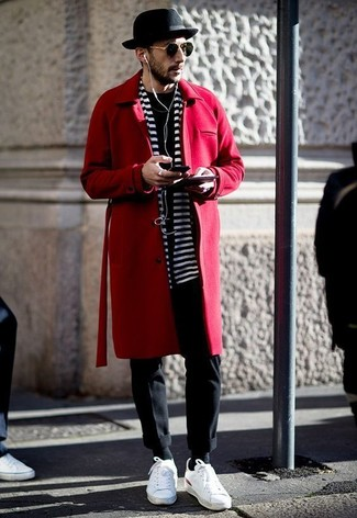 Team a red overcoat with a black and white horizontal striped scarf for a classic and refined silhouette. Take your ensemble into a more casual direction with white leather low top sneakers. This outfit is super comfortable and will help you out in transeasonal weather.