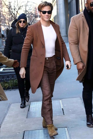 How to wear: brown overcoat, white crew-neck t-shirt, brown vertical striped dress pants, olive suede chelsea boots