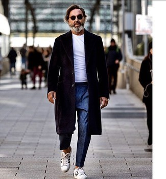 Dark Brown Overcoat Outfits: This is irrefutable proof that a dark brown overcoat and blue dress pants are awesome when worn together in a classy look for today's man. To give your overall outfit a more relaxed vibe, why not add a pair of white and black leather low top sneakers to the equation?