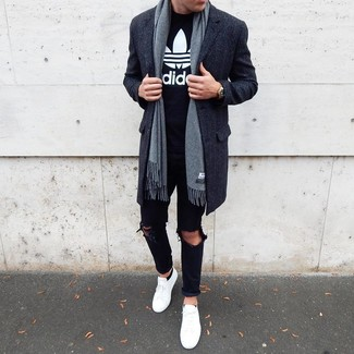 How to wear: charcoal overcoat, black and white print crew-neck t-shirt, black ripped jeans, white low top sneakers