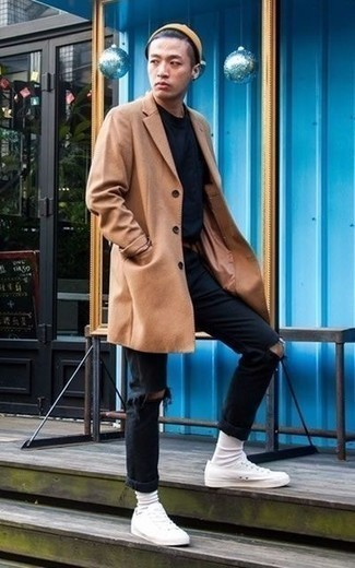 How to Wear Black Jeans For Men: If the situation permits an off-duty look, try teaming a camel overcoat with black jeans. If you wish to easily play down your outfit with footwear, why not introduce white canvas low top sneakers to the equation?