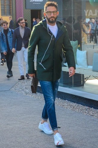 How to Wear White Leather Low Top Sneakers In Cold Weather For Men: If you gravitate towards laid-back style, why not wear this combination of a dark green overcoat and blue ripped jeans? Let your outfit coordination chops truly shine by rounding off this look with a pair of white leather low top sneakers.