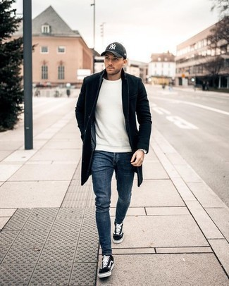 How to Wear Low Top Sneakers For Men: For a casually sleek ensemble, reach for a black overcoat and blue jeans — these pieces go beautifully together. Why not take a more casual approach with shoes and complement your ensemble with low top sneakers?