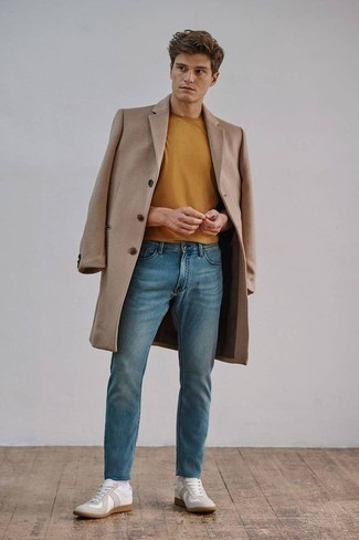 Tobacco Crew-neck T-shirt Outfits For Men: This combo of a tobacco crew-neck t-shirt and blue jeans looks put together and immediately makes any gent look cool. White canvas low top sneakers are a nice pick to complete your look.