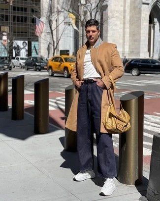 White Athletic Shoes Outfits For Men: This pairing of a camel overcoat and navy jeans is really a statement-maker. Puzzled as to how to finish? Add white athletic shoes to the equation for a more laid-back vibe.