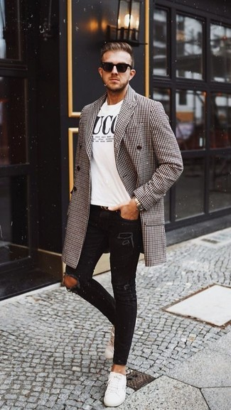 How to wear: brown houndstooth overcoat, white and black print crew-neck t-shirt, black ripped skinny jeans, white leather low top sneakers