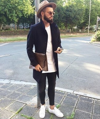 How to Wear Charcoal Skinny Jeans For Men: Choose a navy overcoat and charcoal skinny jeans for an everyday ensemble that's full of style and personality. Not sure how to round off? Complete your outfit with white leather low top sneakers to shake things up.