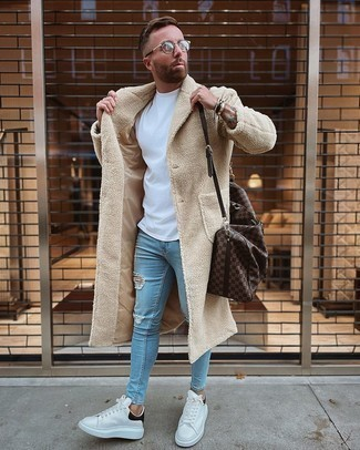 Bag Outfits For Men: Fashionable and functional, this combination of a beige overcoat and a bag brings variety. A pair of white and black leather low top sneakers looks right at home with this look.