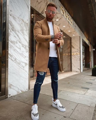 Silver Sunglasses Outfits For Men: Pair a camel overcoat with silver sunglasses if you're on the lookout for a look option that speaks casual dapperness. Complement your getup with white and black print leather low top sneakers et voila, this getup is complete.