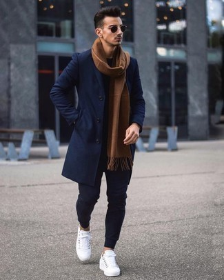 How to Wear Navy Sweatpants For Men: Dress in a navy overcoat and navy sweatpants for a casual and fashionable outfit. Add an easy-going vibe to this look by wearing a pair of white canvas low top sneakers.