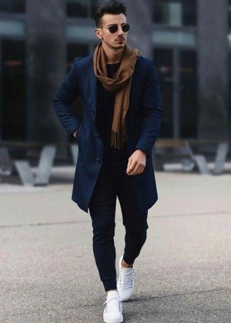 How to Wear Navy Sweatpants For Men: This off-duty combination of a navy overcoat and navy sweatpants is very easy to throw together in no time flat, helping you look dapper and ready for anything without spending too much time searching through your closet. Avoid looking overdressed by rounding off with a pair of white leather low top sneakers.