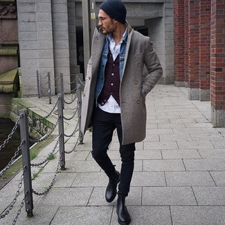 No matter where you go over the course of the evening, you'll be stylishly prepared in a grey overcoat and a black beanie. Black leather chelsea boots complement this outfit quite nicely. You see here this ensemble is also a great illustration of how to style warm clothes in the colder months.