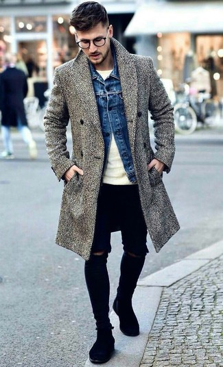 How to wear: grey herringbone overcoat, blue denim jacket, beige crew-neck sweater, black ripped skinny jeans