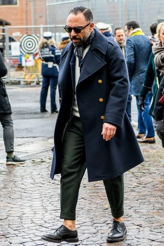 How to wear: black overcoat, navy denim jacket, beige crew-neck sweater, olive dress pants