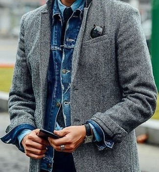 How to wear: grey herringbone overcoat, blue denim jacket, light blue denim shirt, black chinos