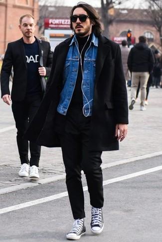 How to wear: black overcoat, blue denim jacket, black turtleneck, black chinos