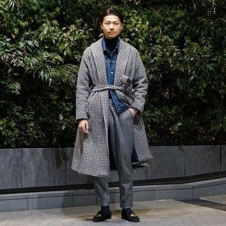 Men's Outfits 2020: A white and black houndstooth overcoat and grey dress pants are a classy outfit that every modern man should have in his sartorial arsenal. Let your styling credentials truly shine by finishing your getup with black embroidered velvet loafers.