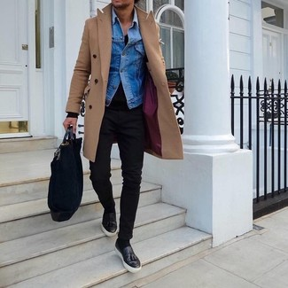How to wear: camel overcoat, blue denim jacket, black v-neck sweater, black skinny jeans