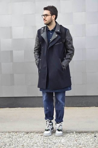 How to Wear a Navy Denim Shirt For Men: Pairing a navy denim shirt with navy ripped jeans is a savvy pick for an off-duty yet stylish outfit. Our favorite of a multitude of ways to complement this outfit is a pair of grey leather high top sneakers.