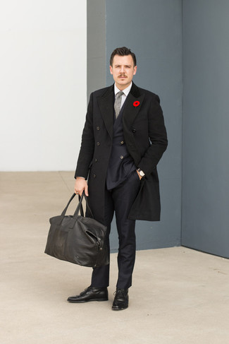 Make a black overcoat and a grey wool tie your outfit choice for incredibly stylish attire. Complement this outfit with black leather dress boots. You can bet this getup will become your favorite when fall arrives.