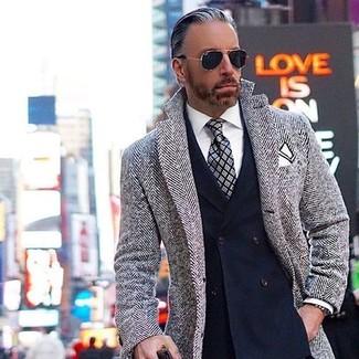 How to wear: grey herringbone overcoat, navy double breasted blazer, white dress shirt, grey plaid tie