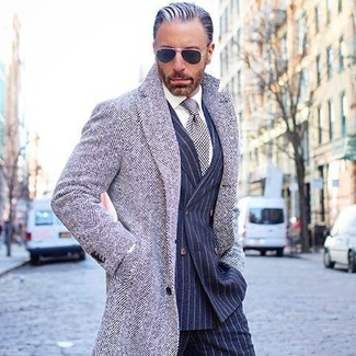 How to wear: grey herringbone overcoat, navy vertical striped double breasted blazer, white dress shirt, navy vertical striped dress pants