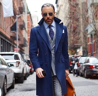 How to wear: navy overcoat, grey vertical striped double breasted blazer, light blue dress shirt, grey vertical striped dress pants