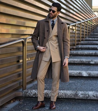 How to wear: brown overcoat, tan double breasted blazer, white and black vertical striped dress shirt, khaki dress pants