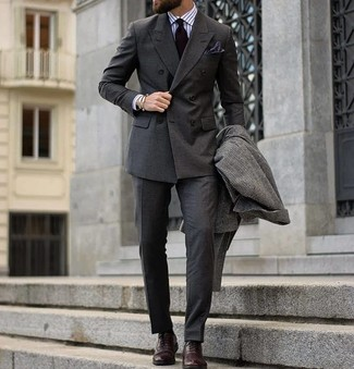 How to wear: charcoal check overcoat, charcoal double breasted blazer, white vertical striped dress shirt, charcoal dress pants