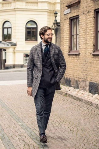 How to Wear Charcoal Socks For Men: A grey houndstooth overcoat and charcoal socks are among the crucial elements in any guy's great casual sartorial collection. Get a little creative when it comes to footwear and add dark brown leather tassel loafers to the mix.