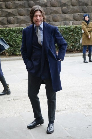 1200+ Cold Weather Outfits For Men: Choose a navy overcoat and charcoal wool dress pants for a really smart ensemble. For something more on the cool and laid-back side to finish off this outfit, make black leather loafers your footwear choice.