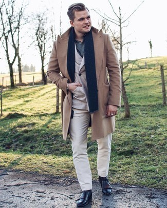 Black Leather Chelsea Boots Outfits For Men: Pairing a camel overcoat with white dress pants is a great option for a smart and polished look. Finishing off with a pair of black leather chelsea boots is a surefire way to infuse a touch of stylish nonchalance into your look.