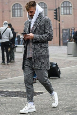 How to Wear Grey Wool Chinos: For an ensemble that's casually smart and wow-worthy, dress in a black and white houndstooth overcoat and grey wool chinos. Get a little creative in the footwear department and add a pair of white leather low top sneakers to the equation.