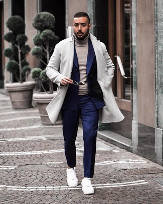 How to wear: grey overcoat, navy double breasted blazer, grey turtleneck, navy dress pants