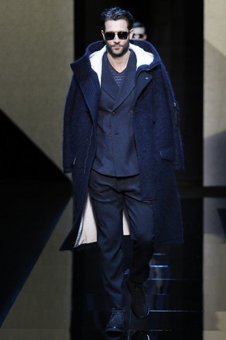 How To Wear a Navy Blazer With a Blue V-neck Sweater For Men: Here, the refined style translates to a navy blazer and a blue v-neck sweater. Add navy suede desert boots to the equation to infuse a dash of stylish casualness into this look.