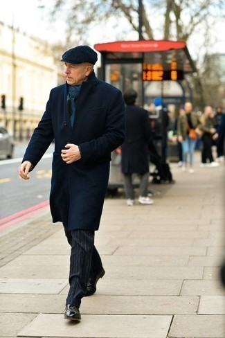 Navy Overcoat Outfits After 50: This pairing of a navy overcoat and navy vertical striped dress pants can only be described as devastatingly stylish and elegant. Dial down your ensemble with a pair of black leather chelsea boots. When it comes to style tips for over-50 guys, this getup is perfect.