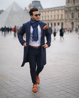 How to Wear a Brown Leather Belt For Men: This contemporary combo of a navy overcoat and a brown leather belt can only be described as ridiculously stylish. To give your overall look a smarter vibe, why not complement your outfit with a pair of tobacco leather double monks?