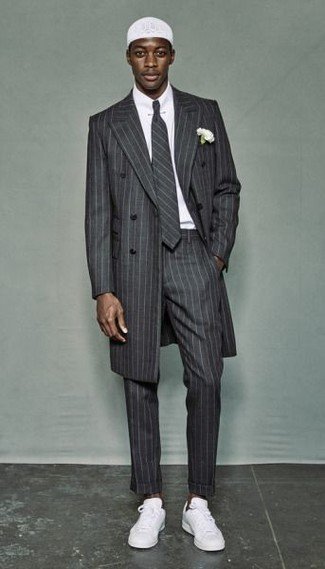 How to wear: grey vertical striped overcoat, white dress shirt, grey vertical striped dress pants, white low top sneakers