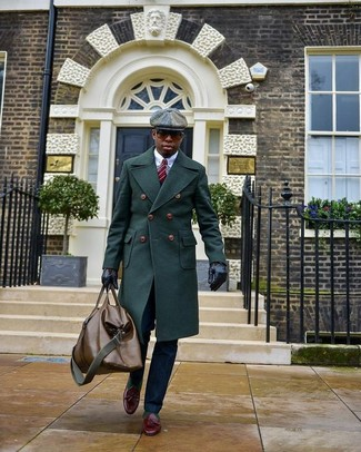 How to Wear a Brown Leather Holdall In Your 30s In Chill Weather For Men: A dark green overcoat and a brown leather holdall are a good combo to add to your casual styling repertoire. Burgundy leather tassel loafers will infuse an added dose of class into an otherwise utilitarian look.