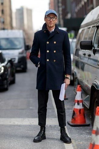 How to Wear a Baseball Cap For Men: A navy overcoat and a baseball cap are a wonderful ensemble to add to your daily styling arsenal. Why not complement your look with black leather brogue boots for an added touch of style?