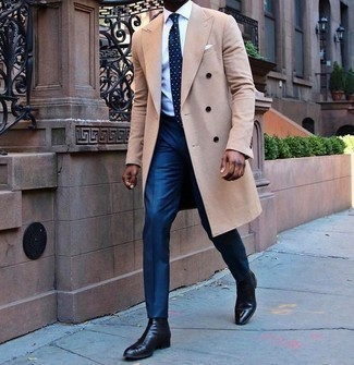 How to Wear Blue Dress Pants For Men: A camel overcoat looks so sophisticated when worn with blue dress pants. For shoes, stick to the casual route with a pair of black leather chelsea boots.