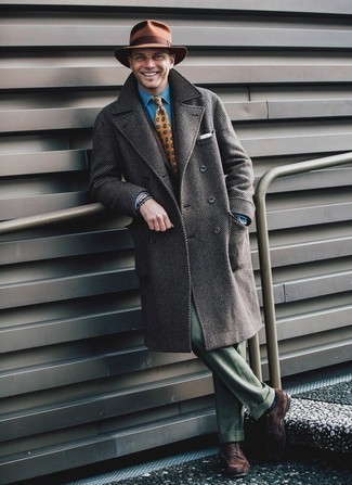 Green Pants Outfits For Men: You're looking at the undeniable proof that a grey overcoat and green pants look amazing when married together in a sophisticated look for today's guy. To introduce a bit of flair to your getup, introduce dark brown suede derby shoes to this getup.