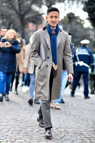 1200+ Cold Weather Outfits For Men: This classy pairing of a grey overcoat and grey dress pants is a must-try ensemble for any modern gent. For times when this look looks all-too-fancy, dial it down by rocking dark brown leather tassel loafers.