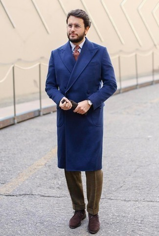 1200+ Cold Weather Outfits For Men: This elegant pairing of a blue overcoat and brown check dress pants will be a good manifestation of your outfit coordination expertise. Opt for dark brown suede desert boots to make a classic outfit feel suddenly fresh.