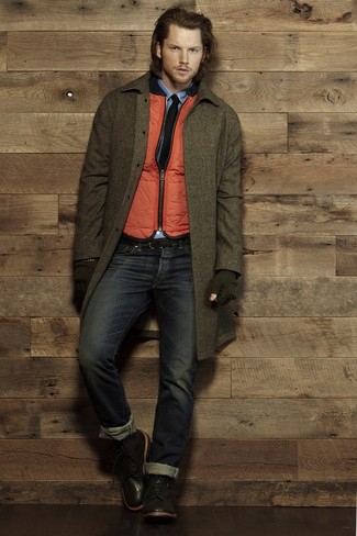 How to wear: olive overcoat, orange quilted gilet, blue long sleeve shirt, navy jeans