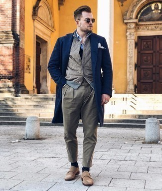 Gilet Outfits For Men: A gilet and olive chinos are must-have menswear essentials if you're planning a casual closet that holds to the highest fashion standards. Add tan suede double monks to the equation to immediately turn up the wow factor of your look.