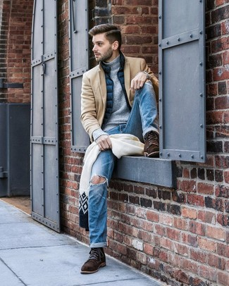 How to wear: camel overcoat, navy gilet, grey knit turtleneck, blue ripped jeans